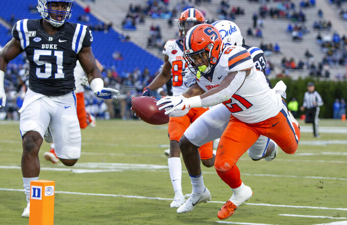 Syracuse's Moe Neal (21) dives towards the goal line during the first half of an NCAA college football game against Duke in Durham, N.C., Saturday, Nov. 16, 2019. Neal's run was ruled just short of the goal line. (AP Photo/Ben McKeown)