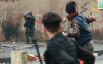 Security forces try to disperse anti-government protesters during ongoing protests in Baghdad, Iraq, Tuesday, Feb. 25, 2020. (AP Photo/Hadi Mizban)