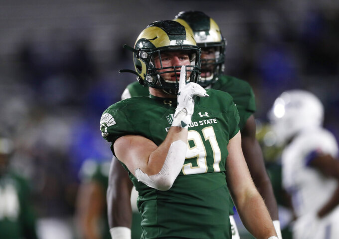 Colorado State defensive lineman Jan-Phillip Bombek gestures after he hurried Air Force quarterback Donald Hammond III to throw an incomplete pass in the first half of an NCAA football game Saturday, Nov. 16, 2019 in Fort Collins, Colo. (AP Photo/David Zalubowski)