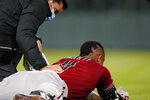 Arizona Diamondbacks' Ketel Marte received medical attention after an injury while running out a ground ball during the sixth inning of the team's baseball game against the Colorado Rockies on Wednesday, April 7, 2021, in Denver. (AP Photo/David Zalubowski)