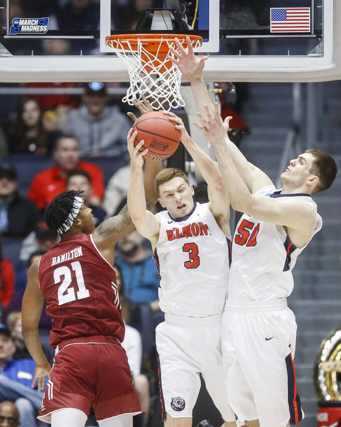 Belmont's Dylan Windler (3) battles for a rebound against Temple's Justyn Hamilton (21) during the first half of a First Four game of the NCAA college basketball tournament, Tuesday, March 19, 2019, in Dayton, Ohio. (AP Photo/John Minchillo)