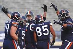 Virginia players celebrate a touchdown during an NCAA college football game  against Louisville Saturday, Nov. 14, 2020, in Charlottesville, Va. (Erin Edgerton/The Daily Progress via AP)