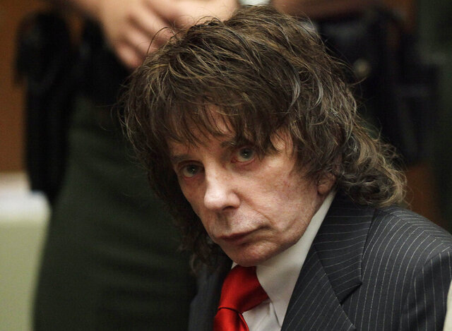 "FILE - In this May 29, 2009 file photo, music producer Phil Spector sits in a courtroom for his sentencing in Los Angeles. Spector, the eccentric and revolutionary music producer who transformed rock music with his ""Wall of Sound"" method and who was later convicted of murder, died Saturday, Jan. 16, 2021, at age 81.  (AP Photo/Jae C. Hong, Pool, File)"