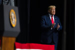President Donald Trump arrives to speak at the North Carolina Opportunity Now Summit, at Central Piedmont Community College, Friday, Feb. 7, 2020, in Charlotte, N.C. (AP Photo/Evan Vucci)