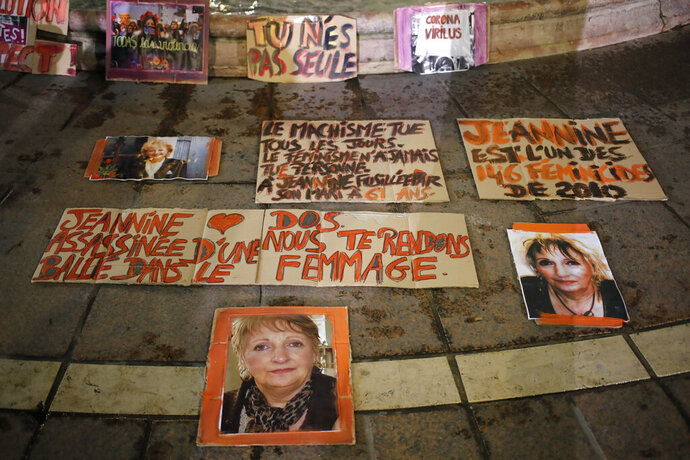 Posters of women victims of domestic violence are pictured at the Saint Michel fountain Wednesday, Nov. 25, 2020 in Paris. With domestic violence on the rise amid the pandemic, activists are holding protests Wednesday from France to Turkey and world dignitaries are trying to find ways to protect millions of women killed or abused every year by their partners. (AP Photo/Francois Mori)