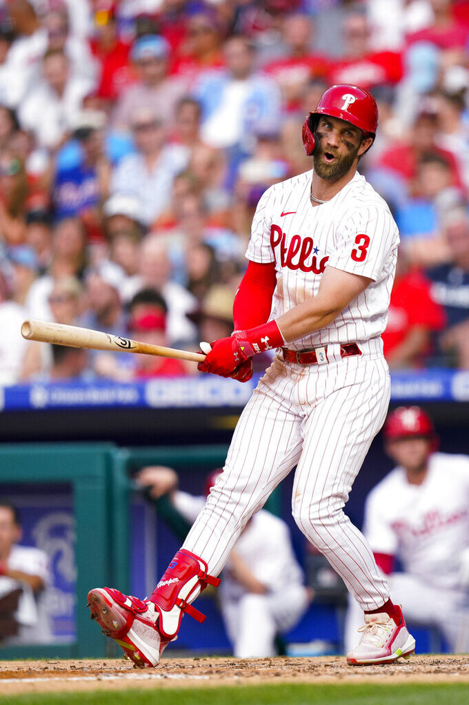Philadelphia Phillies' Bryce Harper reacts to striking out to end the third inning of the team's baseball game against the Atlanta Braves, Saturday, July 24, 2021, in Philadelphia. (AP Photo/Chris Szagola)