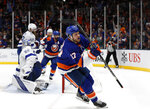 New York Islanders left wing Matt Martin (17) celebrates after scoring a goal against Tampa Bay Lightning goaltender Andrei Vasilevskiy (88) during the second period of Game 4 of an NHL hockey Stanley Cup semifinal, Saturday, June 19, 2021, in Uniondale, N.Y. (AP Photo/Jim McIsaac)