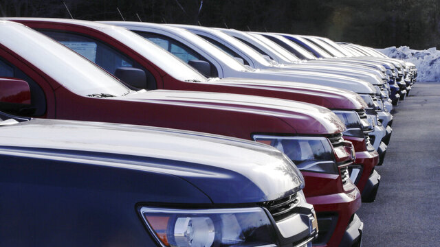 In this Jan. 9, 2020, photo pick-up trucks are lined up for sale on the sales lot at Betley Chevrolet dealership in Derry, N.H. On Thursday, Jan. 16, the Commerce Department releases U.S. retail sales data for December. (AP Photo/Charles Krupa)