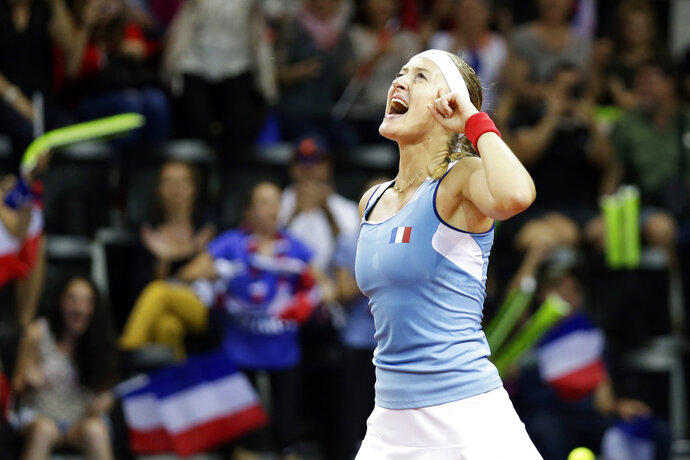 France's Kristina Mladenovic celebrates after winning her Fed Cup semifinal singles tennis match against United States' Coco Vandeweghe, in Aix-en-Provence, southern France, Saturday, April 21, 2018. (AP Photo/Claude Paris)