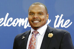 FILE - In this April 29, 2016, file photo, former Walter Payton Man of the Year Chester Pitts poses for photos upon arriving for the third round of the 2016 NFL football draft in Chicago. In the Austin, Texas area Pitts, who played nine pro seasons as a guard and tackle, has been directly involved in getting out the vote for years. Often, he has chartered a bus and helped the elderly get to their polling places. He has similar plans for this fall during the coronavirus pandemic. (AP Photo/Nam Y. Huh, File)
