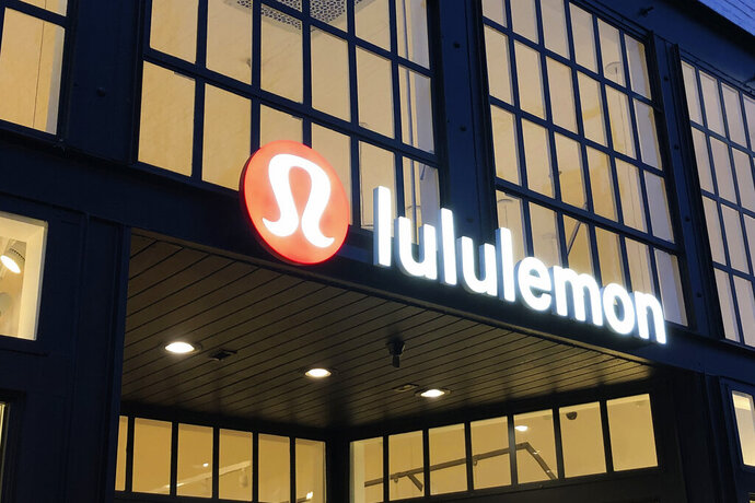 FILE - This Feb. 20, 2020 file photo shows a Lululemon sign in Burlingame, Calif. Athletic apparel maker Lululemon Athletica Inc. said Monday, June 29, 2020 it's acquiring at-home exercise startup Mirror for $500 million. The deal is part of Lululemon's plan to expand beyond just selling yoga tights and other workout clothing. (AP Photo/Jeff Chiu, File)