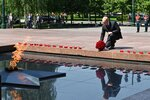 Russian President lays a bunch of flowers at the eternal flame in memory of those killed during WWII as he takes part in a wreath laying ceremony at the Tomb of Unknown Soldier in Moscow, Russia, Tuesday, June 22, 2021, marking the 80th anniversary of the Nazi invasion of the Soviet Union. (Alexei Nikolsky, Sputnik, Kremlin Pool Photo via AP)