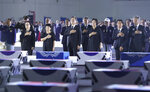 South Korean President Moon Jae-in, center, left, and his wife Kim Jung-sook salute to a national flag during a ceremony to mark the 70th anniversary of the Korean War at the Seoul airport in Seongnam, South Korea, Thursday, June 25, 2020. (Kim Ju-sung/Yonhap via AP)
