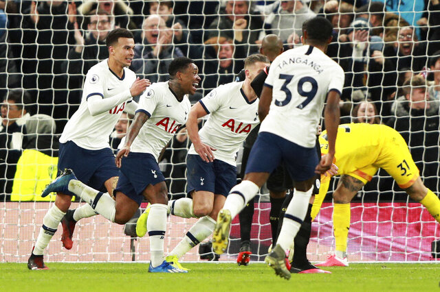 Tottenham's Steven Bergwijn, 2nd left, celebrates after scoring the opening goal during the English Premier League soccer match between Tottenham Hotspur and Manchester City at the Tottenham Hotspur Stadium in London, England, Sunday, Feb. 2, 2020. (AP Photo/Ian Walton)