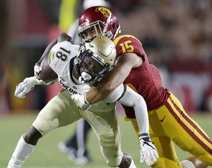 FILE - In this Oct. 13, 2018 file photo, Colorado wide receiver Tony Brown (18) is tackled by Southern California safety Talanoa Hufanga (15) during the second half of an NCAA college football game in Los Angeles. XXXX (AP Photo/Marcio Jose Sanchez, File)