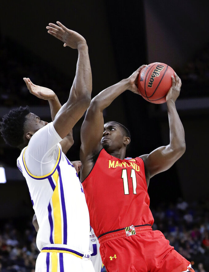 Maryland's Darryl Morsell (11) takes a shot against LSU's Kavell Bigby-Williams, left, during the first half of a second-round game in the NCAA men's college basketball tournament in Jacksonville, Fla., Saturday, March 23, 2019. (AP Photo/John Raoux)