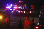 Emergency crews work the scene where multiple people were shot outside a senior living apartment complex, Wednesday, Sept. 16, 2020, in Mayville, Wis.  Medical helicopters were called to the scene to transport the injured. (Doug Raflik/The Reporter via AP)