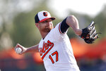 Baltimore Orioles starting pitcher Alex Cobb (17) works against the Minnesota Twins in the first inning of a spring training baseball game Saturday, March 23, 2019, in Sarasota, Fla. (AP Photo/John Bazemore)