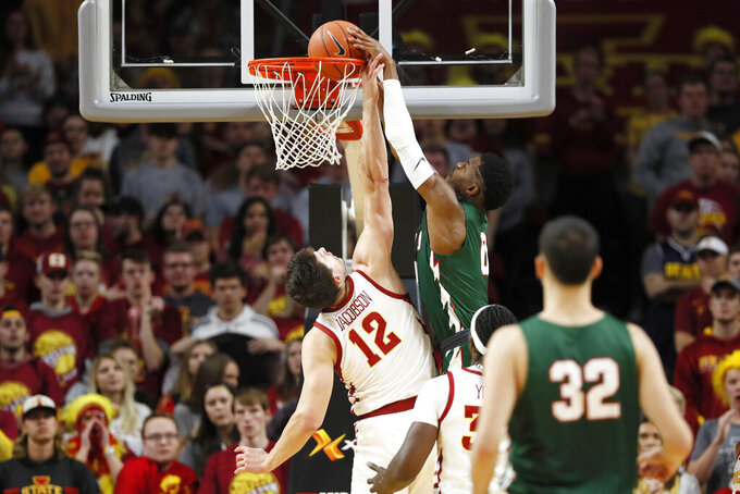 Mississippi Valley State forward Jordan Lyons dunks the ball over Iowa State forward Michael Jacobson (12) during the first half of an NCAA college basketball game, Tuesday, Nov. 5, 2019, in Ames, Iowa. (AP Photo/Charlie Neibergall)