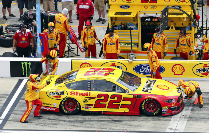 Joey Logano gets fuel during a pit stop in the early laps of the NASCAR Cup Series auto race at Daytona International Speedway, Sunday, July 7, 2019, in Daytona Beach, Fla. (AP Photo/David Graham)