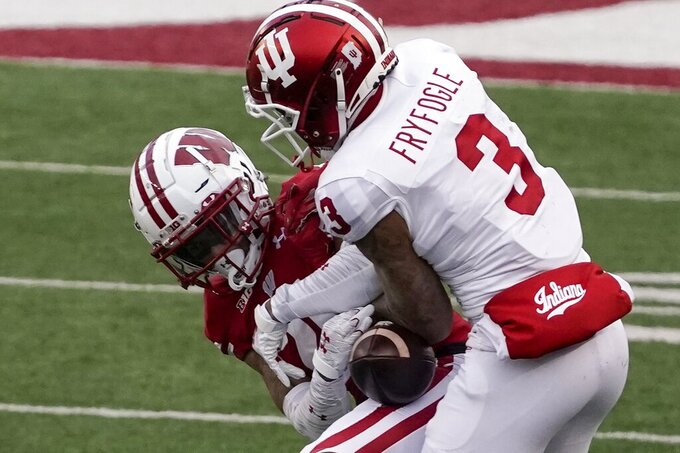 Wisconsin cornerback Caesar Williams breaks up a pass intended for Indiana wide receiver Ty Fryfogle during the first half of an NCAA college football game Saturday, Dec. 5, 2020, in Madison, Wis. (AP Photo/Morry Gash)