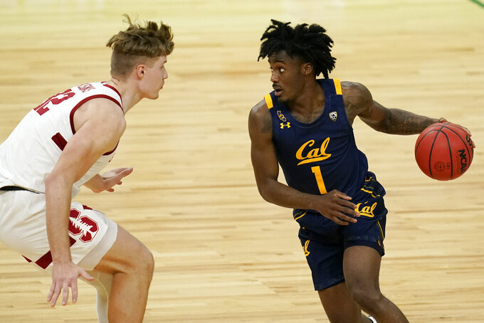 California's Joel Brown (1) drives into Stanford's Lukas Kisunas (32) during the first half of an NCAA college basketball game in the first round of the Pac-12 men's tournament Wednesday, March 10, 2021, in Las Vegas. (AP Photo/John Locher)