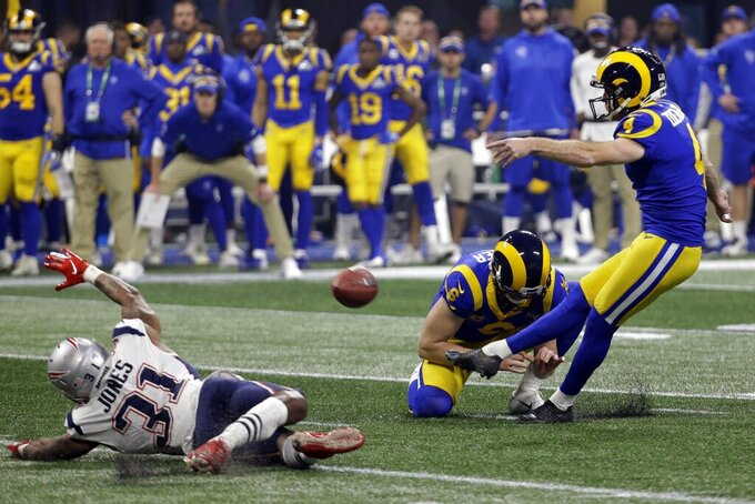 oLos Angeles Rams' Greg Zuerlein (4) kicks a field goal as Johnny Hekker (6) holds during the second half of the NFL Super Bowl 53 football game Sunday, Feb. 3, 2019, in Atlanta. At left is New England Patriots' Jonathan Jones (31). (AP Photo/Mark Humphrey)