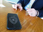In this Wednesday, May 1, 2019, photo, Anchorage Police Chief Justin Doll shows his phone, which is tapped into a new national wireless network dedicated to first responders. Anchorage police are among public safety agencies across the country that have adopted the service knowns as FirstNet. (AP Photo/Rachel D'Oro)