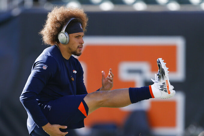 FILE - In this Dec. 2, 2018, file photo, Denver Broncos running back Phillip Lindsay practices before an NFL football game against the Cincinnati Bengals, in Cincinnati. He didn't get invited to the NFL combine and wasn't selected in the NFL draft. Then, an injury threatened to keep Phillip Lindsay from the spoils of his sensational season, the Pro Bowl. Although he won't be playing, the Denver Broncos rookie running back is attending the league's annual all-star game as a social media correspondent for the league. (AP Photo/Gary Landers, File)