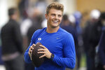 BYU quarterback Zach Wilson warms up before participating in the school's pro day football workout for NFL scouts Friday, March 26, 2021, in Provo, Utah. (AP Photo/Rick Bowmer)