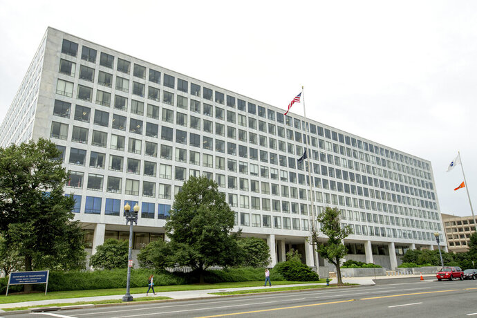 FILE - This Friday, June 19, 2015 file photo shows the Department of Transportation Federal Aviation Administration building, in Washington. For more than six decades, the Federal Aviation Administration has relied on employees of airplane manufacturers to do government-required safety inspections as planes are being designed or assembled. But critics say the system, dubbed the