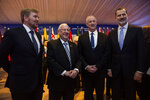 From left, King Willem-Alexander of the Netherlands, Israeli President Reuven Rivlin, Blue and White leader Benny Gantz, and Spain's King Felipe VI  pose for a photograph during a dinner reception in Jerusalem on Wednesday, Jan. 22, 2020.  Dozens of world leaders have descended upon Jerusalem for the largest-ever gathering focused on commemorating the Holocaust and combating modern-day anti-Semitism.  (Heidi Levine/Pool photo via AP)