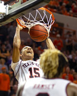 Texas Tech's Kevin McCullar dunks the ball against Oklahoma State during an NCAA college basketball game in Stillwater, Okla., Saturday, Feb. 15, 2020. (AP Photo/Mitch Alcala)