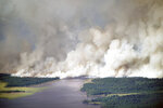 As the Greenwood Fire continues to burn, smoke from the blaze fills the air near Slater Lake as fire crews set back fires to better control the perimeter, Wednesday, Aug. 25, 2021, in Isabella, Minn. (Brian Peterson/Star Tribune via AP)