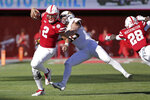 Nebraska quarterback Adrian Martinez (2) runs with the ball away from a tackle-attempt by Minnesota linebacker Blake Cashman (36) during the first half of an NCAA college football game in Lincoln, Neb., Saturday, Oct. 20, 2018. (AP Photo/Nati Harnik)