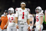 FILE -= Ohio State quarterback Justin Fields watches during the second half of the Sugar Bowl NCAA college football game against Clemson Friday, Jan. 1, 2021, in New Orleans. Fields is a likely first round pick in the NFL Draft, April 29-May 1, 2021, in Cleveland.(AP Photo/John Bazemore, File)