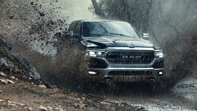 FILE - This file photo provided by Ram Truck Brand shows a scene from the company's Super Bowl spot. The Ram truck ad that used a speech by Martin Luther King, Jr., is drawing a backlash. The ad shows people doing service-oriented tasks set against audio of King's speech, which urges people to be