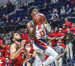 Mississippi guard Bryce Williams (13) goes to the basket in front of Seattle guard Terrell Brown (23) during an NCAA college basketball game Tuesday, Nov. 19, 2019, in Oxford, Miss. (Bruce Newman/The Oxford Eagle via AP)
