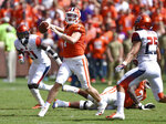 Clemson quarterback Chase Brice throws a pass during the second half of an NCAA college football game against Syracuse Saturday, Sept. 29, 2018, in Clemson, S.C. Clemson won 27-23. (AP Photo/Richard Shiro)