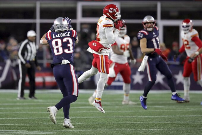 Kansas City Chiefs defensive back Bashaud Breeland, center, intercepts a pass intended for New England Patriots tight end Matt LaCosse in the first half of an NFL football game, Sunday, Dec. 8, 2019, in Foxborough, Mass. (AP Photo/Charles Krupa)