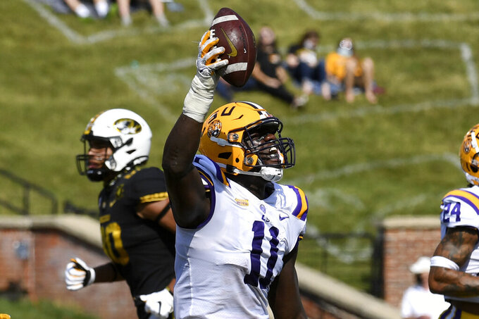 LSU defensive lineman Ali Gaye celebrates after a turnover by Missouri during the first half of an NCAA college football game Saturday, Oct. 10, 2020, in Columbia, Mo. (AP Photo/L.G. Patterson)