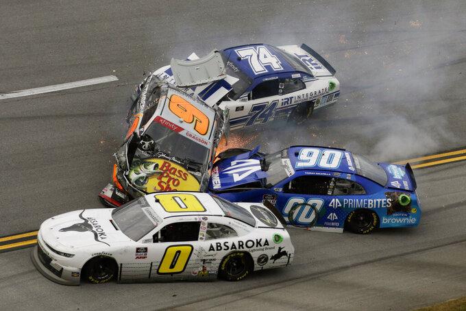 Noah Gragson (9), Caesar Bacarella (9), Jeffrey Earnhardt (0) and C.J. McLaughlin (74) tangle in a wreck during a NASCAR Xfinity Series auto race Saturday, Oct. 2, 2021, in Talladega, Ala. (AP Photo/Russell Norris)