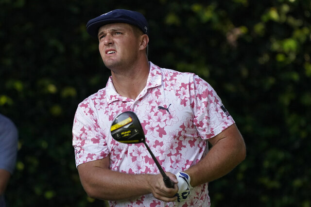 Bryson DeChambeau watches his tee shot on the second hole during the third round of the Masters golf tournament Saturday, Nov. 14, 2020, in Augusta, Ga. (AP Photo/Charlie Riedel)
