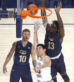 Utah State guard Abel Porter (15) shoots as Montana State guard Caleb Bellach (10) and forward Jubrile Belo (13) defend during an NCAA college basketball game Tuesday, Nov. 5, 2019, in Logan, Utah. (Eli Lucero/The Herald Journal via AP)