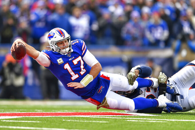 Buffalo Bills quarterback Josh Allen (17) is tackled by Denver Broncos defensive end Dre'Mont Jones (93) first quarter of an NFL football game, Sunday, Nov. 24, 2019, in Orchard Park, N.Y. (AP Photo/Adrian Kraus)