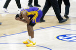 LSU's Aundre Hyatt (15) pauses on the court after LSU lost to Alabama in the championship game at the NCAA college basketball Southeastern Conference Tournament Sunday, March 14, 2021, in Nashville, Tenn. (AP Photo/Mark Humphrey)