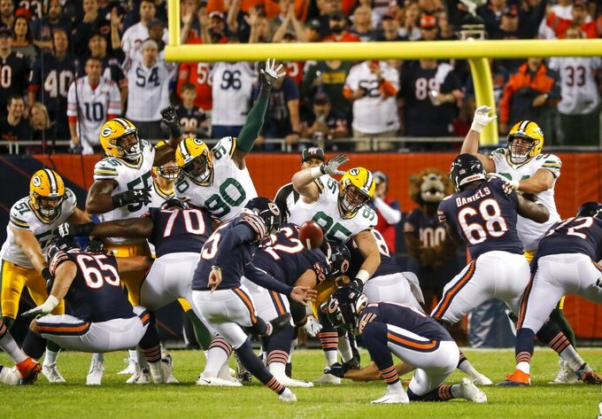 Chicago Bears' Eddy Pineiro kicks 1 field goal during the first half of an NFL football game against the Green Bay Packers Thursday, Sept. 5, 2019, in Chicago. (AP Photo/Charles Rex Arbogast)
