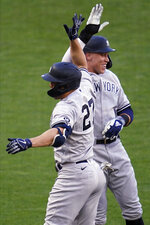 New York Yankees' Giancarlo Stanton (27) and Aaron Judge celebrate Stanton's three-run home run off Minnesota Twins' pitcher J.A. Happ during the first inning of a baseball game Thursday, June 10, 2021, in Minneapolis. (AP Photo/Jim Mone)