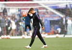 Tottenham coach Mauricio Pochettino bounces the ball during a training session at the Wanda Metropolitano stadium in Madrid, Friday May 31, 2019. English Premier League teams Liverpool and Tottenham Hotspur are preparing for the Champions League final which takes place in Madrid on Saturday night. (AP Photo/Bernat Armangue)