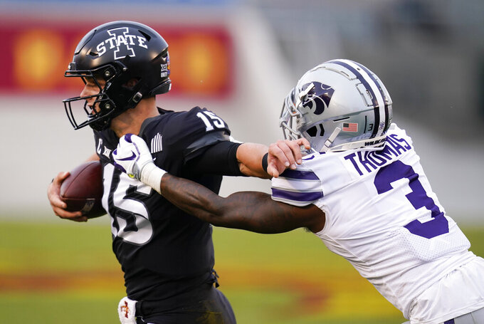 "FILE - In this Nov. 21, 2020, file photo, Iowa State quarterback Brock Purdy (15) breaks a tackle by Kansas State defensive back Kiondre Thomas (3) during the first half of an NCAA college football game in Ames, Iowa. Iowa State won 45-0. ""That was a pretty embarrassing loss. That is just something that we have to put behind us,"" Thomas said. Kansas State plays Baylor this week. (AP Photo/Charlie Neibergall, File)"